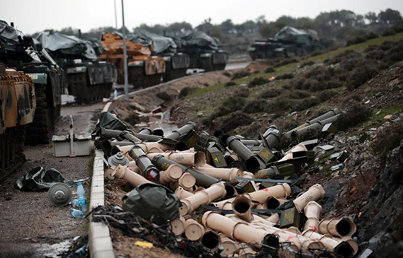 Empty shells are seen next to Turkish army tanks on the Turkish-Syrian border in Hatay province, Turkey, on January 23, 2018.