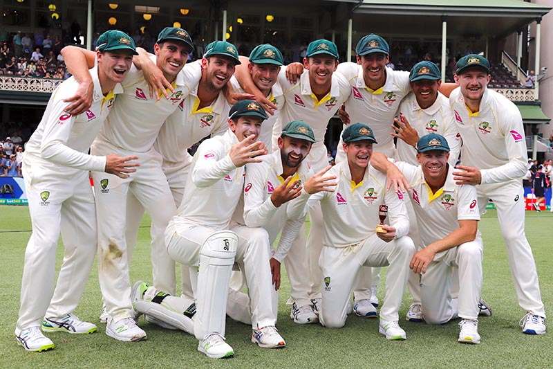 Australia's captain Steve Smith holds a replica Ashes urn next to team mates after they won the fifth Ashes cricket test match and the series 4-0. Photo: Reuters