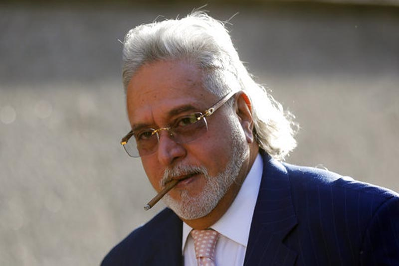 In this Dec. 14, 2017 file photo, F1 Force India team boss Vijay Mallya arrives at Westminster Magistrates Court in London. A New Delhi court has declared Indiau2019s flamboyant tycoon Vijay Mallya a u201cproclaimed offenderu201d for failing to appear to answer allegations of money laundering by flouting foreign currency laws. Thursdayu2019s order paves the way for the government to take over Mallyau2019s businesses and real estate holdings. (AP Photo/Frank Augstein, File)