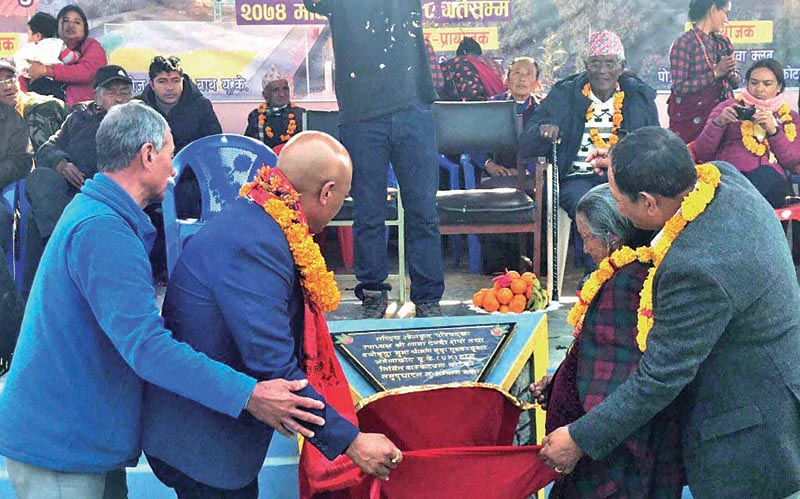NSC Vice-president Lama Tendi Sherpa (left) and senior citizen Munga Gurung inaugurating the basketball court in Armala, Pokhara on Tuesday. Photo: THT