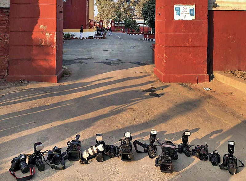 Cameras put on the ground by protesting photojournalists at the gate of the Office of the President, on Friday, January 19, 2018. Photo: THT