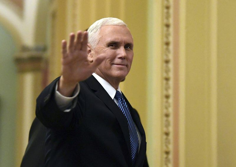 U.S. Vice President Mike Pence waves as he walks on Capitol Hill in Washington. Penceu2019s upcoming visit to the Mideast comes at a time of friction between his administration and the Palestinian leadership, posing a dilemma for Arab hosts Egypt and Jordan on how to safeguard their vital ties with Washington without appearing to ignore Palestinian misgivings.
