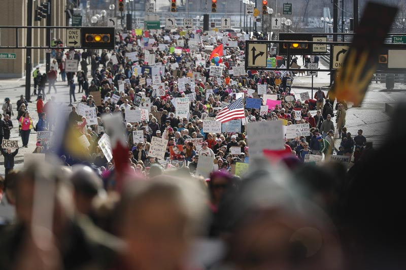 Protestors participate in a Women's March highlighting demands for equal rights and equality for women, Saturday, on Jan. 20, 2018, in Cincinnati. Photo: AP
