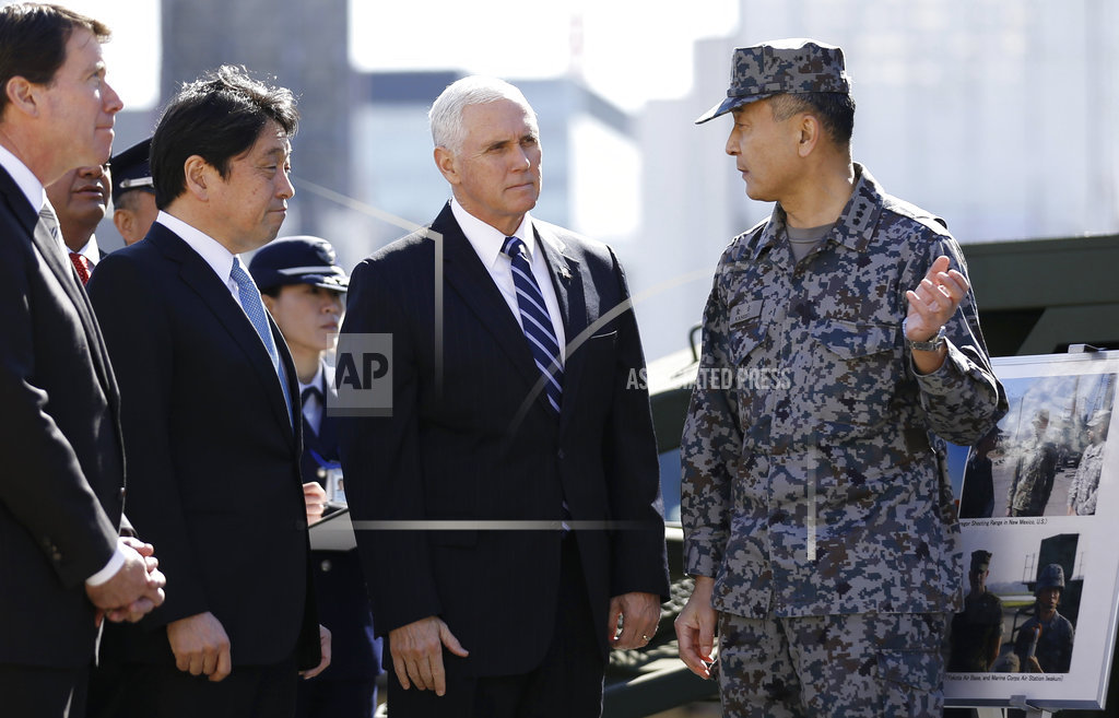 U.S. Vice President Mike Pence, second from right, speaks with an officer of the Japan's Ground Self-Defense Force as he inspects a PAC-3 interceptor missile system with Japanese Defense Minister Itsunori Onodera, second from left, at Defense Ministry in Tokyo Wednesday, Feb. 7, 2018. Pence, who arrived Tuesday in Japan, said he has not ruled out the possibility of meeting with North Korean officials at the upcoming Olympics in South Korea. (Toru Hanai/Pool Photo via AP)
