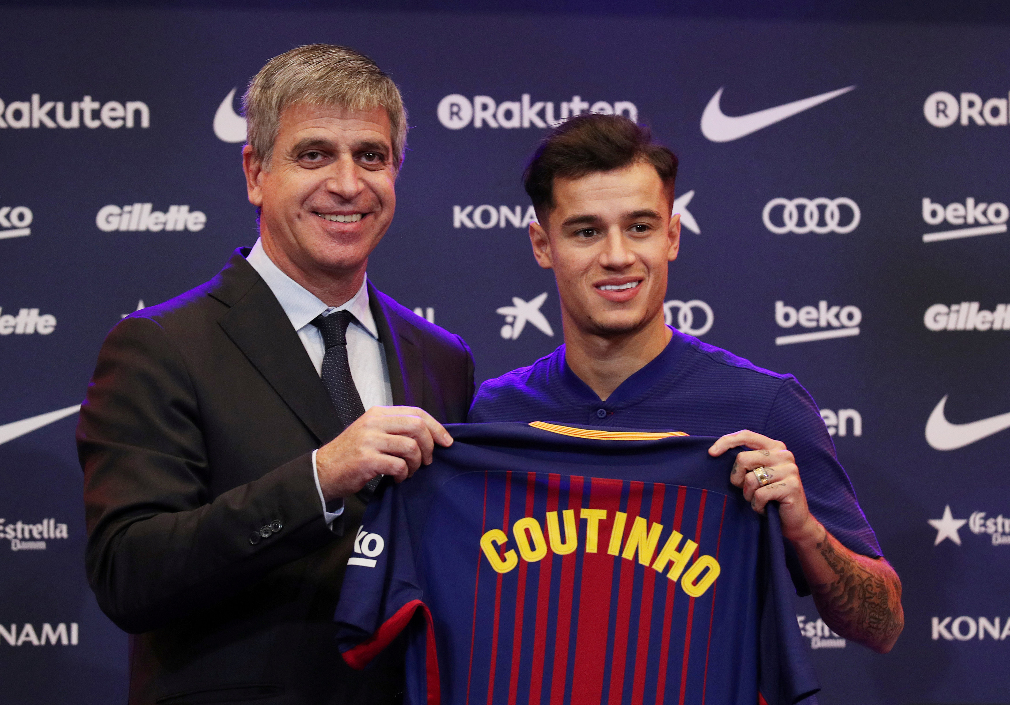 FILE PHOTO: Soccer Football - FC Barcelona - Philippe Coutinho News Conference - Auditorium 1899, Barcelona, Spain - January 8, 2018   FC Barcelona's new signing Philippe Coutinho and Jordi Mestre pose with the club shirt   REUTERS/Albert Gea/File Photo