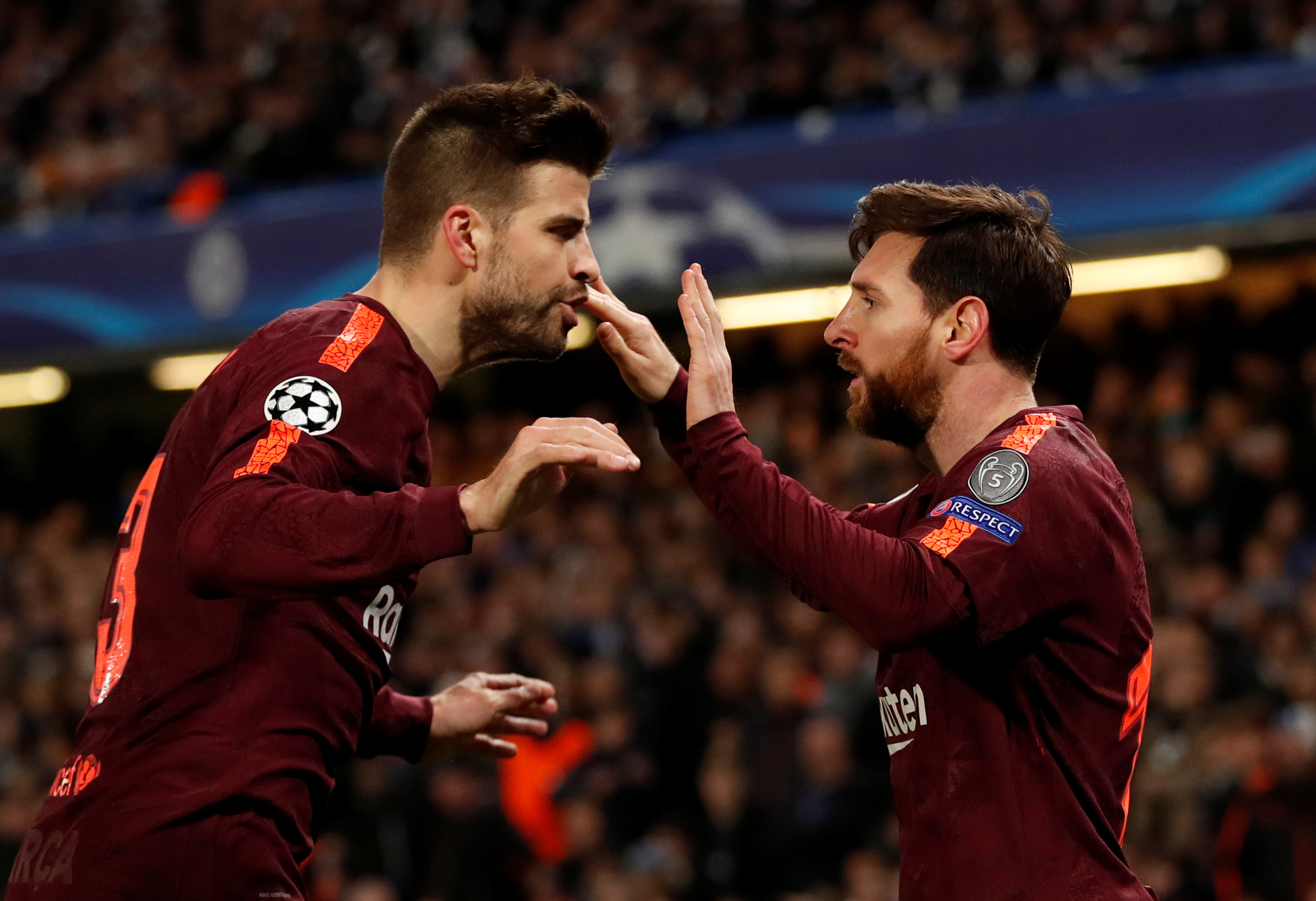 Soccer Football - Champions League Round of 16 First Leg - Chelsea vs FC Barcelona - Stamford Bridge, London, Britain - February 20, 2018   Barcelonau2019s Lionel Messi celebrates scoring their first goal with Gerard Pique                                Action Images via Reuters/Andrew Boyers