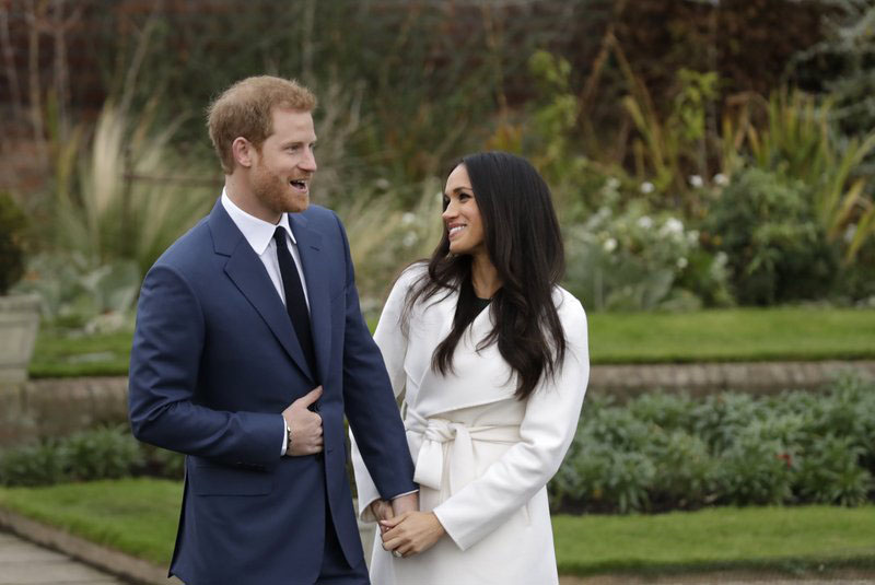 FILE-In this file photo dated Monday Nov. 27, 2017, Britainu0092s Prince Harry and his fiancee Meghan Markle pose for photographers in the grounds of Kensington Palace in London, following the announcement of their engagement. Speculation is mounting over who will be invited to the May 19, 2018, royal wedding of Prince Harry and Meghan Markle, with pundits guessing about the wedding guest list. Photo: AP