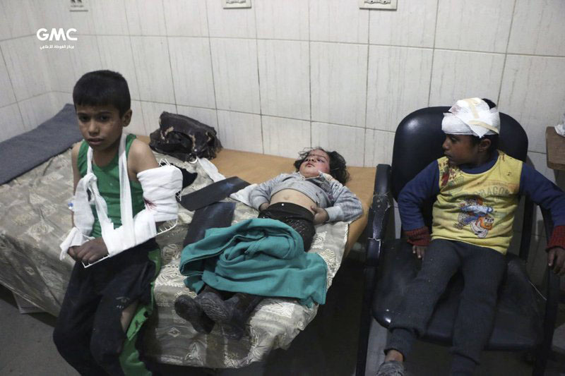 This photo provided by the Syrian anti-government activist group, Ghouta Media Center, GMC, which has been authenticated based on its contents and other AP reporting, shows children receiving treatment at a hospital in Hazeh in eastern Ghouta, the only remaining rebel stronghold near the capital, Damascus, Syria, Monday, Feb. 5, 2018. The Syrian Observatory for Human Rights says waves of airstrikes hit at least five neighborhoods in the eastern Ghouta suburb. Photo: AP