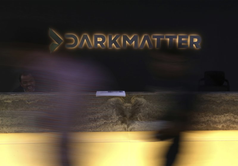 Jan. 30, 2018 photo, taken with a long exposure, employees walk into offices of the cybersecurity firm DarkMatter, in Abu Dhabi, United Arab Emirates. DarkMatter, a growing cybersecurity company thatu2019s recruited Western intelligence analysts, is slowly stepping out of the shadows amid activist concerns about its power. CEO Faisal al-Bannai says DarkMatter takes part in no hacking but acknowledges the firmu2019s close business ties to the Emirati government, as well as hiring former CIA and National Security Agency analysts. Photo: AP