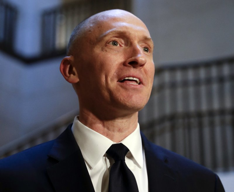 Carter Page speaks with reporters following a day of questions from the House Intelligence Committee on Capitol Hill in Washington. A new congressional memo alleging FBI surveillance abuse is being used to undermine the legitimacy of special counsel Robert Muelleru2019s Russia investigation. But included in the four-page document are revelations that might complicate the effort. Photo: AP