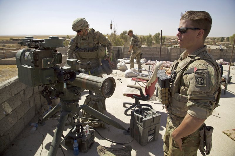 US Army soldiers stands next to a guided-missile launcher, a few miles from the frontline, in the village of Abu Ghaddur, east of Tal Afar, Iraq. American troops have started to draw down from Iraq following Baghdadu2019s declaration of victory over the Islamic State group last year, according to western contractors at a US-led coalition base in Iraq. Photo: AP