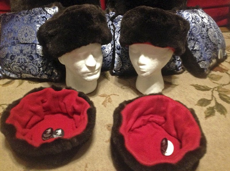 This undated photo shows hats trimmed with sea otter fur, offered by Alaska Native Marcus Ghou2019s Tuvraqtuq online retail store based in Juneau, Alaska. A policy intended to deter the illegal trade of ivory and items made with the parts of endangered or threatened animals led the online sales website Etsy to remove such artwork sold by Alaska Native artists, who can legally use ivory in their pieces. A senator is asking Etsy.com to reconsider, but Etsy is citing the u201cglobal natureu201d of its business. (Marcus Gho via AP