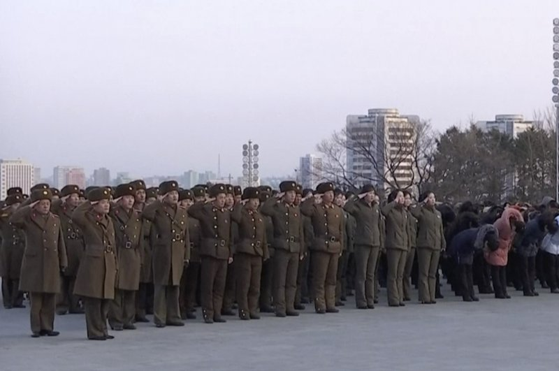 North Korean military personnel salute as they lay flowers in front of giant statues of Kim Il Sung and Kim Jong Il on Mansu Hill in central Pyongyang, Thursday, Feb. 8, 2018. North Korea held a military parade and rally on Kim Il Sung Square on Thursday, just one day before South Korea holds the opening ceremony for the Pyeongchang Winter Olympics. (AP Photo