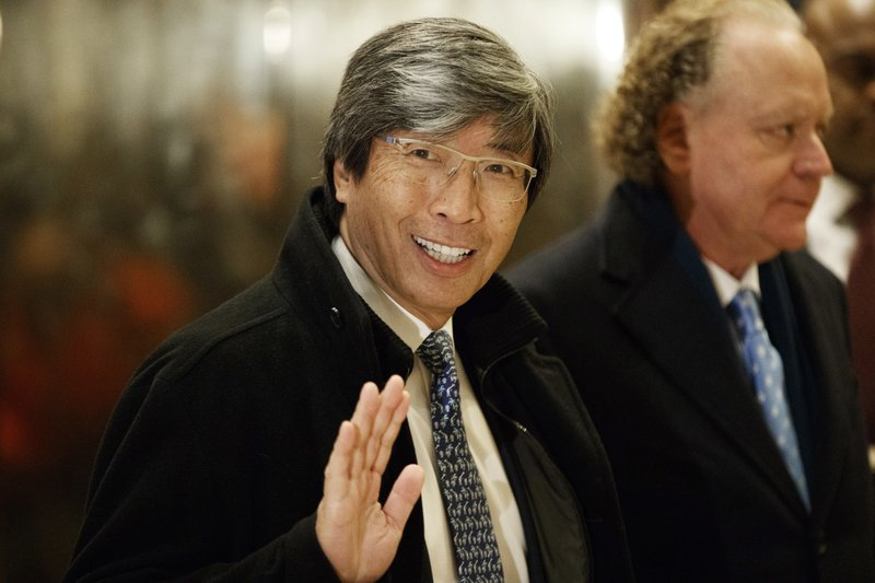 pharmaceuticals billionaire Dr. Patrick Soon-Shiong waves as he arrives in the lobby of Trump Tower in New York for a meeting with President-elect Donald Trump. The Los Angeles Times is reporting its parent company is in talks to be sold to Soon-Shiong. The Washington Post first reported Tuesday, Feb. 6, 2018 that the sale was being negotiated by Tronc Inc., formerly Tribune Publishing. The Times then reported that the price was $500 million and would include the San Diego Union-Tribune. Chicago-based Tronc owns 10 US newspapers.Photo: AP