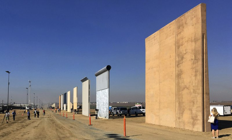 This Oct. 26, 2017 file photo shows prototypes of border walls in San Diego. Federal Judge Gonzalo Curiel was berated by Donald Trump for his handling of lawsuits alleging fraud at now-defunct Trump University. Curiel will hear arguments Friday, Feb. 9, 2018, in a lawsuit that could block construction of a border wall with Mexico, or at least cause major delays