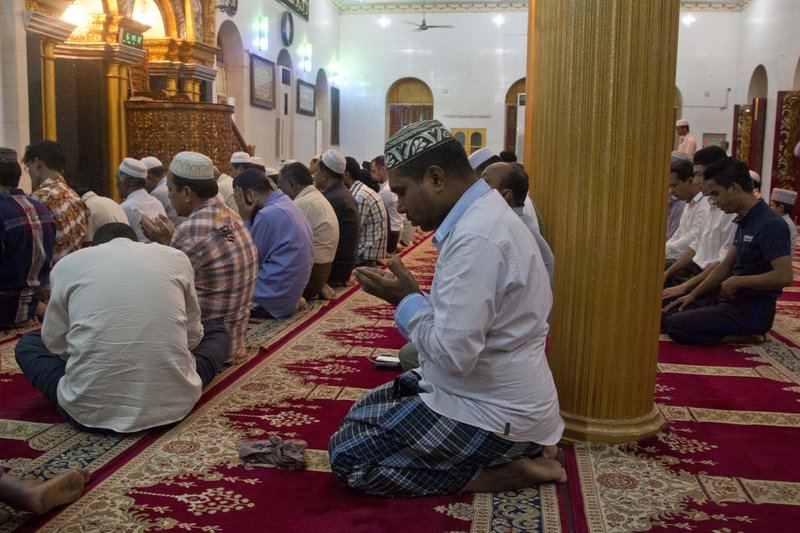 Myanmar Muslim men pray at a mosque in Yangon, Myanmar. Far from the violence and vengeance unfolding in Myanmaru2019s far west, Rohingya Muslims who once felt relatively safe in Yangon describe a sense of rising persecution and hatred, of vanishing freedoms and opportunities, of Buddhist neighbors and friends who are suddenly much more willing to voice sympathies with the militaryu2019s campaign in Rakhine state. Photo: AP