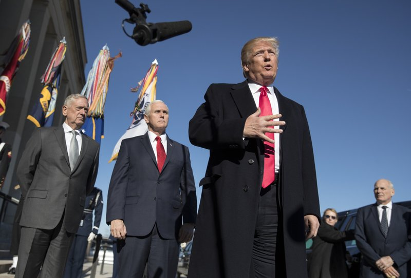 file photo, President Donald Trump, joined by Defense Secretary Jim Mattis, left, Vice President Mike Pence, second from left, and White House Chief of Staff John Kelly, right, speaks to the media as he arrives at the Pentagon. When Jennifer Willoughby first stepped forward to tell the story how she was physically, emotionally and psychologically abused by her ex-husband, who had since become a top aide to President Donald Trump, the White House sent a clear message: We donu2019t believe you. Instead, officials offered effusive support for her accuser.