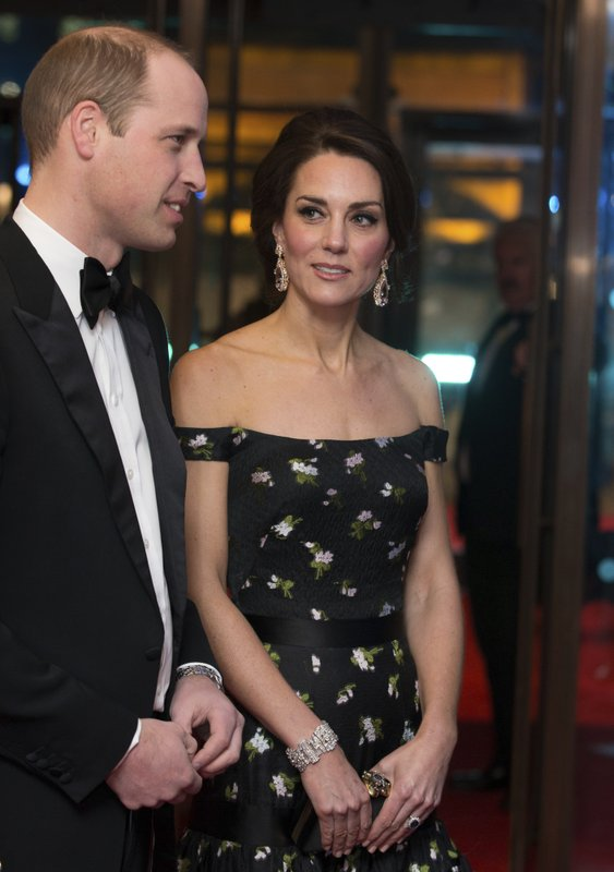 Britainu2019s Prince William and Kate, Duchess of Cambridge meet BAFTA representatives as they arrive to attend the BAFTA British Academy Film Awards at the Royal Albert Hall in London. Photo: AP