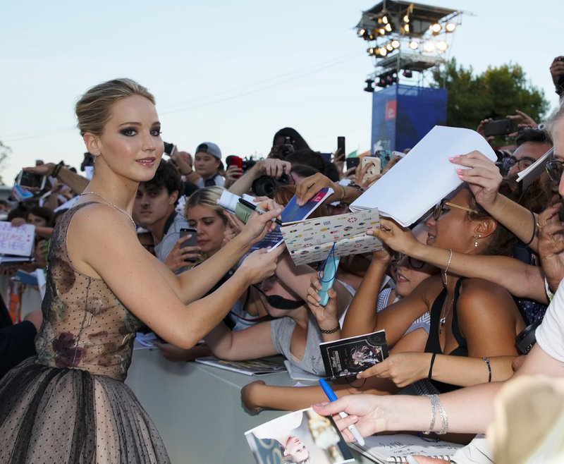 Actress Jennifer Lawrence signs autographs at the premiere of the film u201cmother!u201d at the 74th edition of the Venice Film Festival in Venice, Italy. Photo: AP