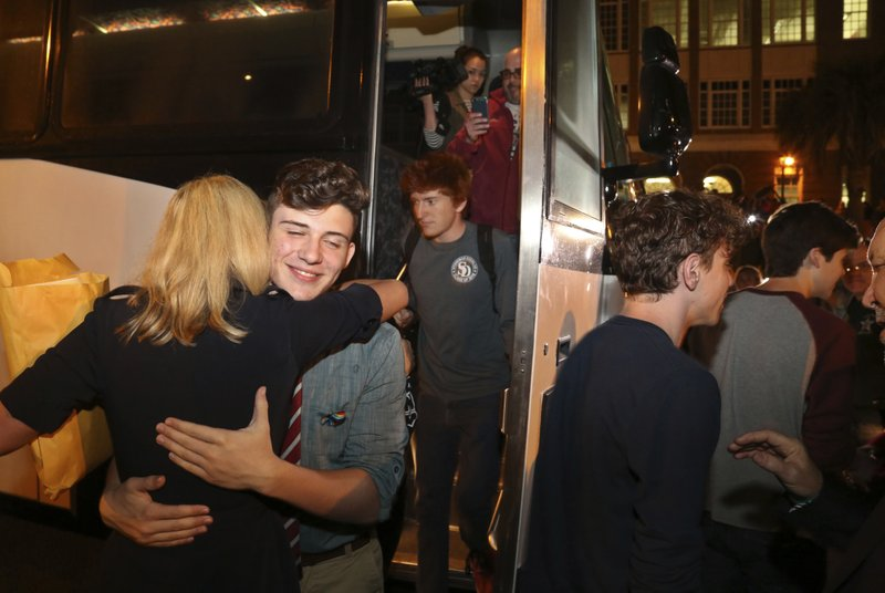 Alfonso Calderon (16) left, a junior at Marjory Stoneman Douglas High School, Parkland, gets a hug from Florida State Sen. Lauren Book as 100 students arrive at Leon High School in Tallahassee, Tuesday, February  20, 2018.Photo: AP