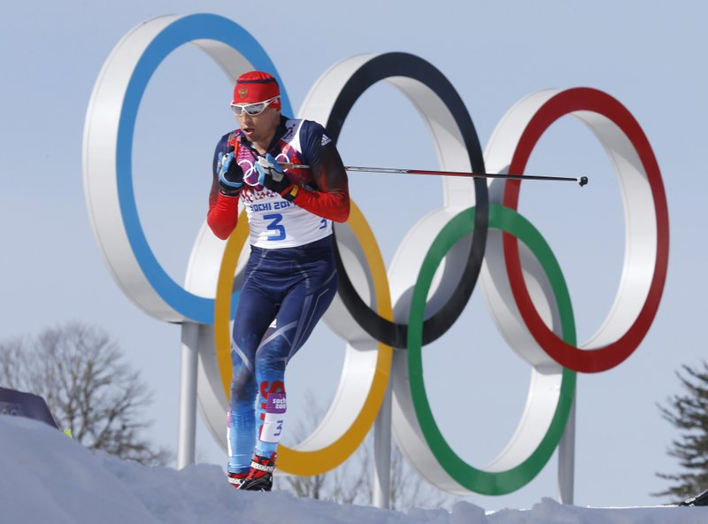 Russiau2019s gold medal winner Alexander Legkov skis past the Olympic rings during the menu2019s 50K cross-country race at the 2014 Winter Olympics in Krasnaya Polyana, Russia. The Court of Arbitration for Sport ruled on Thursday, Feb. 1, 2018 to reinstate Leskov as gold medal winner of the menu2019s 50-kilometer cross-country skiing which he was stripped of on doping allegations earlier. (