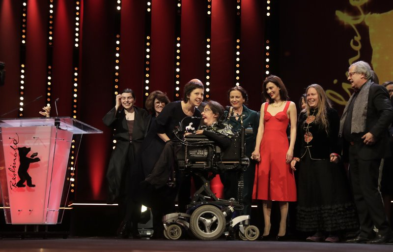 The team of u2018Touch me notu2019 pose on the stage after receiving a golden bear as best film during the awarding ceremony of the 68th edition of the International Film Festival Berlin, Berlinale, in Berlin, Germany, Saturday, February 24, 2018. Photo: AP