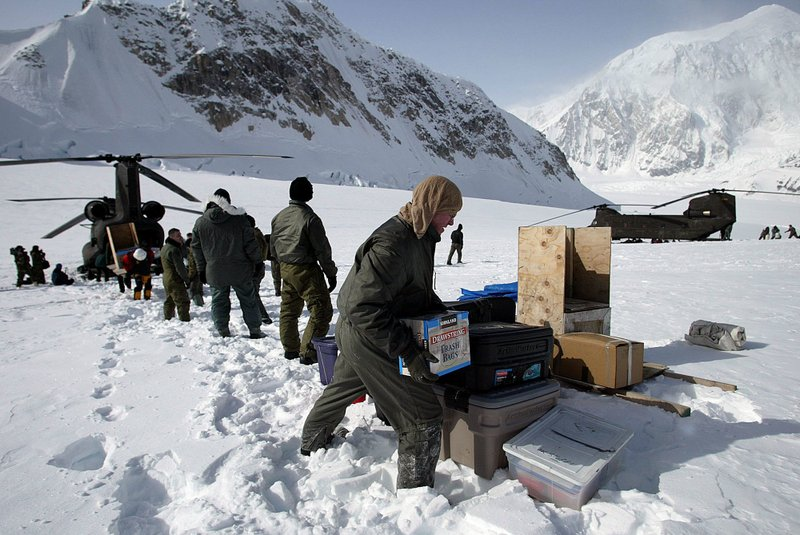 members of the U.S. Armyu2019s High Altitude Rescue Team from Fort Wainwright Army Base near Fairbanks, Alaska, unload supplies from the teamu2019s CH-47 Chinook helicopters for the National Park Serviceu2019s 7,000-foot level Mount McKinley base camp on the Kahiltna Glacier near Talkeetna, Alaska. The National Park Service is considering new rules for the disposal of human waste generated by climbers on North Americau2019s tallest mountain, Denali.