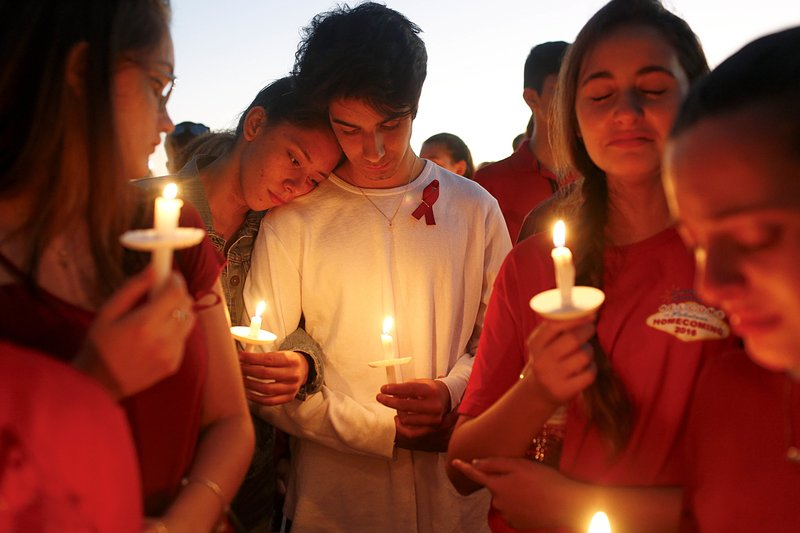 Students gather during a vigil at Pine Trails Park for the victims of the Wednesday shooting at Marjory Stoneman Douglas High School, in Parkland, Fla., Thursday, Feb. 15, 2018. Nikolas Cruz, a former student, was charged with 17 counts of premeditated murder on Thursday. Photo: AP
