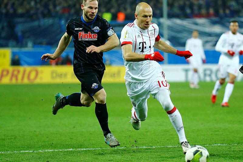 Bayern Munich's Arjen Robben in action with Paderbornu2019s Felix Herzenbruch. Photo: Reuters