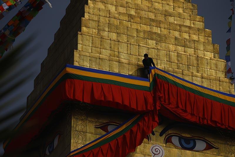 A man arranges the streamer at Bouddhanath Stupa in Kathmandu, on Saturday, February 24, 2018. Photo: Skanda Gautam