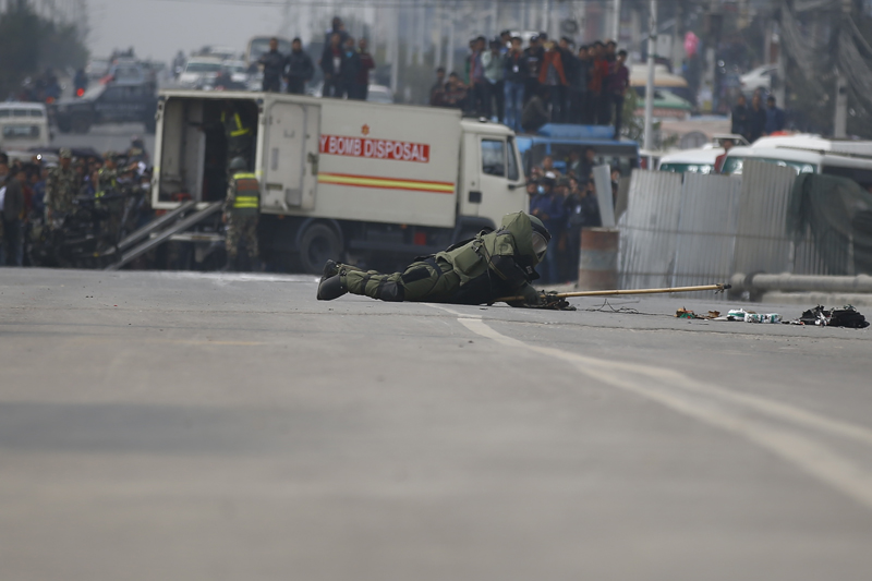 A Nepal Army bomb disposal squad works to diffuse a bomb placed inside a bag found in front of the Metropolitan Police Circle in Kathmandu, on Tuesday, February 20, 2018. The bomb has been found on the day when Netra Bikram Chand 'Biplav'-led Communist Party of Nepal has imposed nationwide general strike. Photo: Skanda Gautam