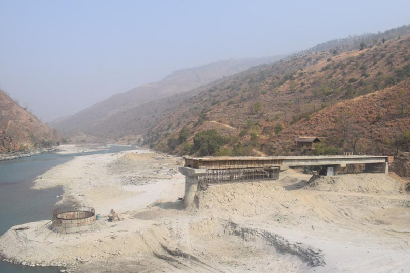 A view of an under-construction bridge connecting Tehrathum and Paanchthar above Tamor river in lumughat. The construction work is only 40% complete which is supposed to be completed within 3 years. The construction work is halted for now as the question on the quality of construction material arises. Photo: RSS