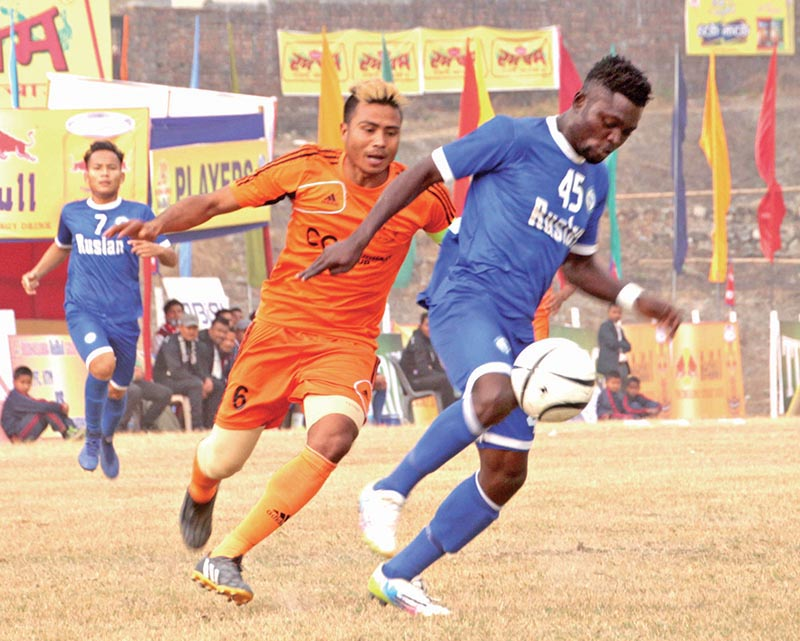 Ajayi Martins of Three Star beats past Chetan Tharu of Farwest during the Budha Subba Gold Cup in Dharan on Tuesday. Photo: THT