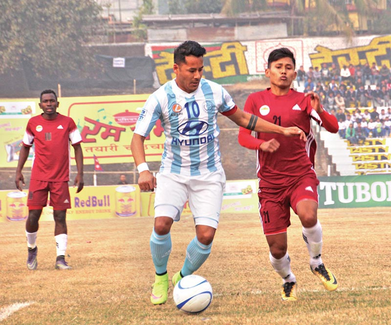 Laxmi Hyundai Manang Marshyangdi Club's Anil Gurung (left) vies for the ball with CMG Club Sankata player during their Budha Subba Gold Cup match in Dharan on Saturday. Photo: THT