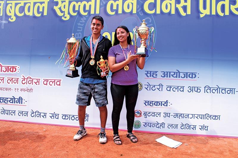 Pranav Khanal and Mayanka Rana hold the titles of the Butwal Open Lawn Tennis Tournament in Devinagar, Bhairahawa on Tuesday. Photo: THT