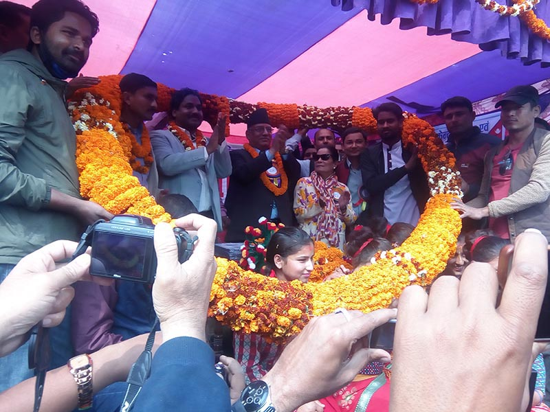 CPN-Maoist Centre Chairman Pushpa Kamal Dahal being welcomed with a 100-kg garland at the inauguration of Dhansar Jungle Sahiya road section, in Rautahat, on Sunday, February 25, 2018. Photo: THT