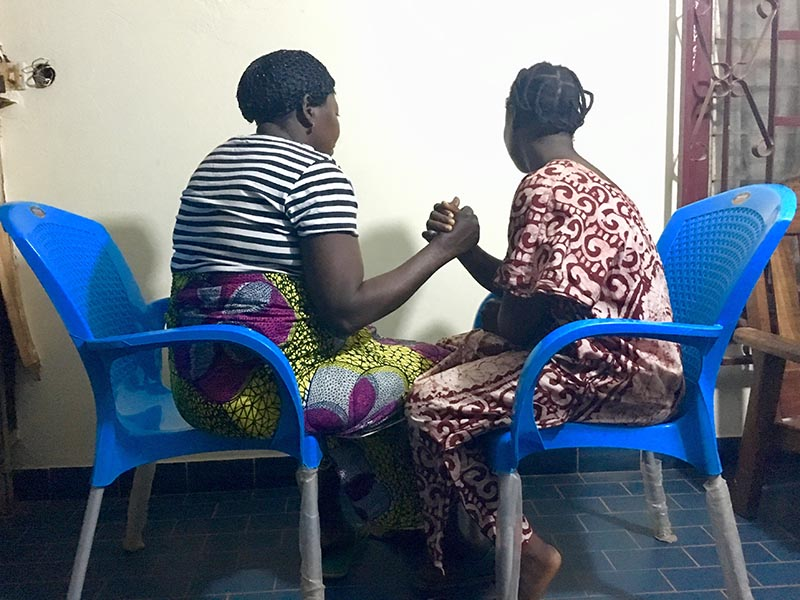 Solange (left) and Hulda (right) sitting together in Bangui, Central African Republic, on January 25, 2018. Photo: Thomson Reuters Foundation / Inna Lazareva