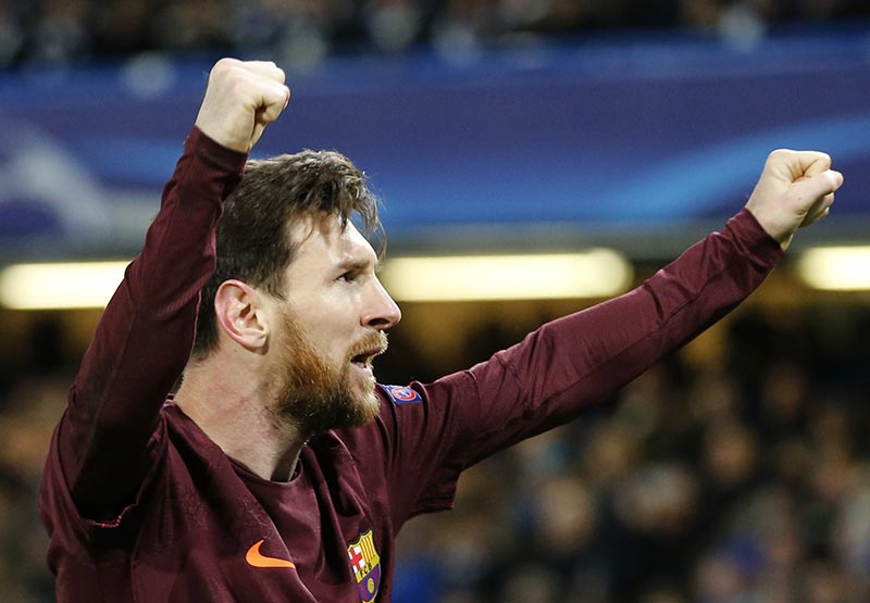 Barcelona's Lionel Messi celebrates scoring his side's first goal during a Champions League round of sixteen first leg soccer match between FC Barcelona and Chelsea at Stamford Bridge stadium in London, on Tuesday, February 20, 2018. Photo: AP