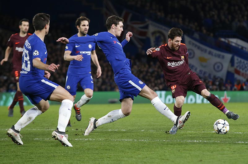 Barcelona's Lionel Messi fights for the ball against Chelsea's Andreas Christensen during a Champions League round of sixteen first leg soccer match between FC Barcelona and Chelsea at Stamford Bridge stadium in London, on Tuesday, February 20, 2018. Photo: AP
