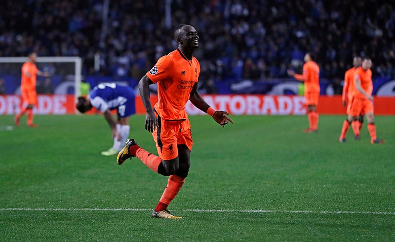 Liverpool's Sadio Mane celebrates scoring their fifth goal and completing his hat trick during the Champions League round of 16 first leg match between FC Porto and Liverpool, at Estadio do Dragao, in Porto, Portugal, on February 14, 2018. Photo:  Action Images via Reuters