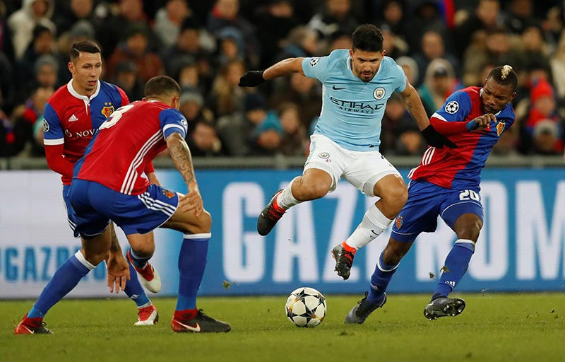 Manchester City's Sergio Aguero in action with Baselu2019s Serey Die during the Champions League match between Basel and Manchester City, at St. Jakob-Park, Basel, Switzerland, on February 13, 2018. Photo:  Action Images via Reuters