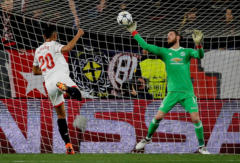 Manchester United's David De Gea makes a save from Sevillau2019s Luis Muriel during the Champions League Round of 16 First Leg match between Sevilla and Manchester United, in Ramon Sanchez Pizjuan, in Seville, Spain, on February 21, 2018. Photo: Reuters