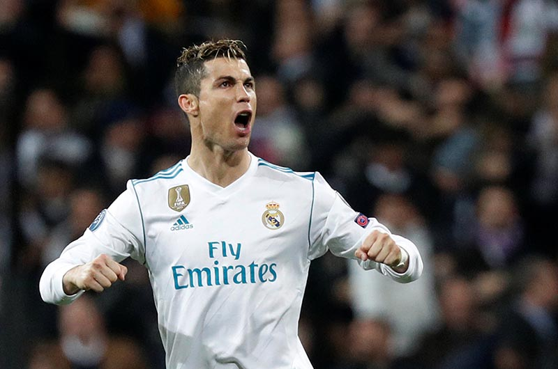 Real Madridu2019s Cristiano Ronaldo celebrates scoring their first goal during the Champions League Round of 16 First Leg match between Real Madrid and Paris Saint-Germain, at Santiago Bernabeu, in Madrid, Spain, on February 14, 2018. Photo: Reuters