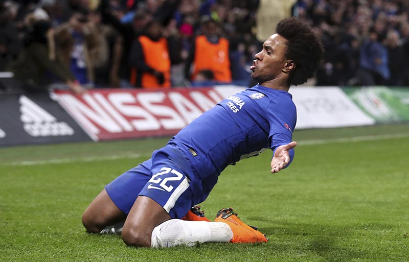 Chelsea's Willian, celebrates scoring his side's first goal of the game during the Champions League round of sixteen first leg soccer match between FC Barcelona and Chelsea at Stamford Bridge stadium in London, on Tuesday, Febriary 20, 2018. Photo: Adam Davy/PA via AP