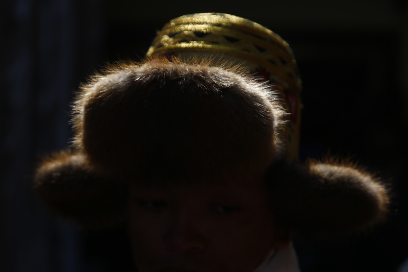 A hat of a Sherpa man is silhouetted during celebrations of the Lunar New Year, marking the Year of the Dog at the Sherpa Monastery in Kathmandu on Sunday, February 18, 2018.
