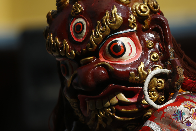 A masked dancer from the Sherpa community dressed in traditional attire performs to celebrate the Lunar New Year, marking the Year of the Dog at the Sherpa Monastery in Kathmandu on Sunday, February 18, 2018.