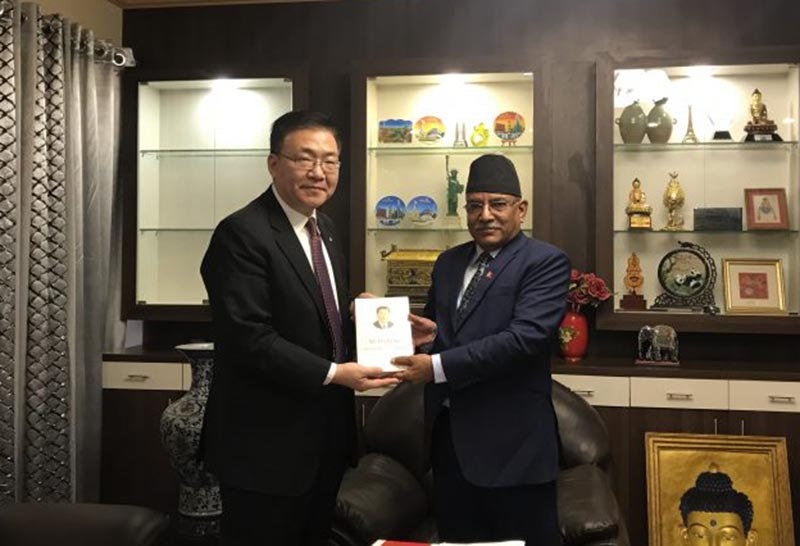 Chinese Vice Minister Gao Yejhao handing over the book 'The Governance of China-2' by Chinese President Xi Jinping to CPN MC Chairman Pushpa Kamal Dahal in Khumaltar, Lalitpur, on Tuesday, February 20, 2018. Photo: cmprachanda.com