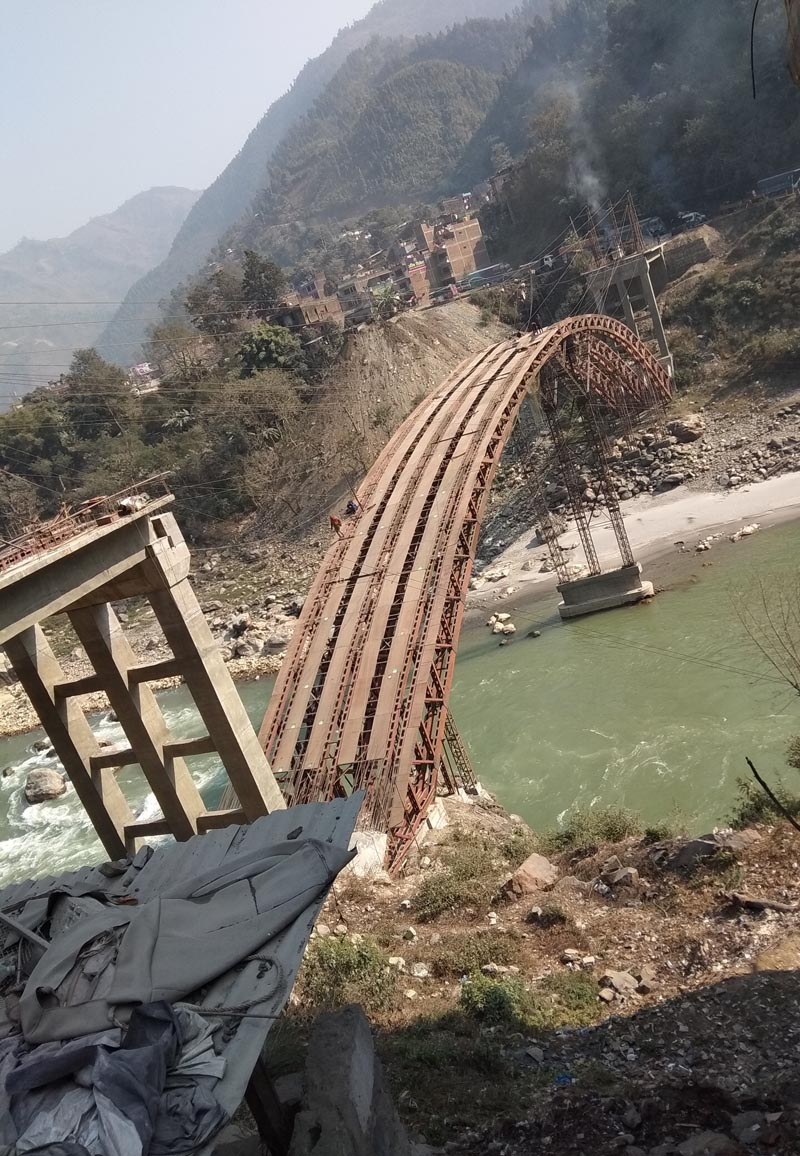 A view of under-construction bridge over Trishuli River that connects Chitwan district with Tanahun district, at Muglin Bazar in Chitwan district, on Saturday, February 3, 2018. The bridge is being constructed along the Prithvi Highway to replace the previous dilapidated bridge. Photo: Tilakram Rimal/THT