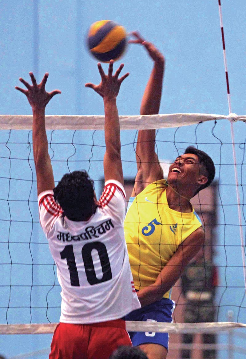Bijay Thapa (right) of Nepa APF Club attempts a spike against Mid-western during CoAS National Volleyball Tournament at Army Sports Complex, Lagankhel in Lalitpur on Thursday. Photo: THT