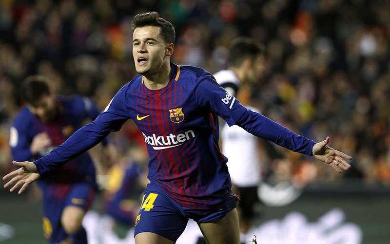 FC Barcelona's Philippe Coutinho celebrates after scoring against Valencia during the Spanish Copa del Rey, semifinal, second leg, soccer match between FC Barcelona and Valencia at the Mestalla stadium in Valencia, Spain, on Thursday Feb. 8, 2018. Photo: AP